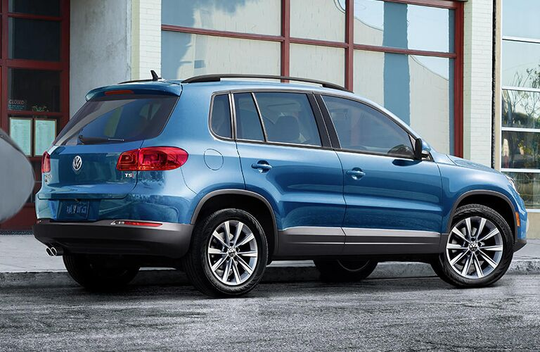 rear and side view of blue 2018 volkswagen tiguan limited parked on street in front of building
