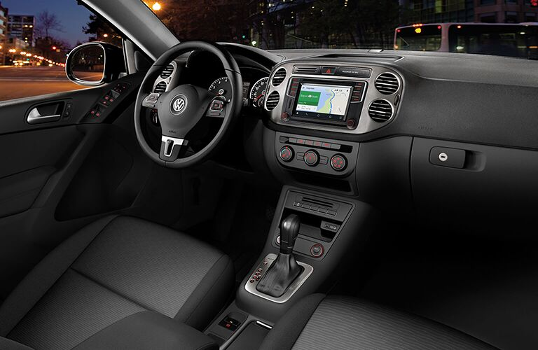 front interior of 2018 volkswagen tiguan limited including steering wheel and center infotainment system