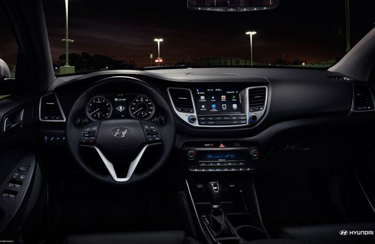 front interior of 2018 hyundai tucson including steering wheel, dashboard and infotainment system