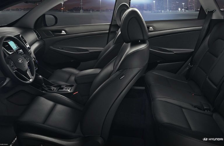 side view of interior of 2018 hyundai tucson including front and rear seating