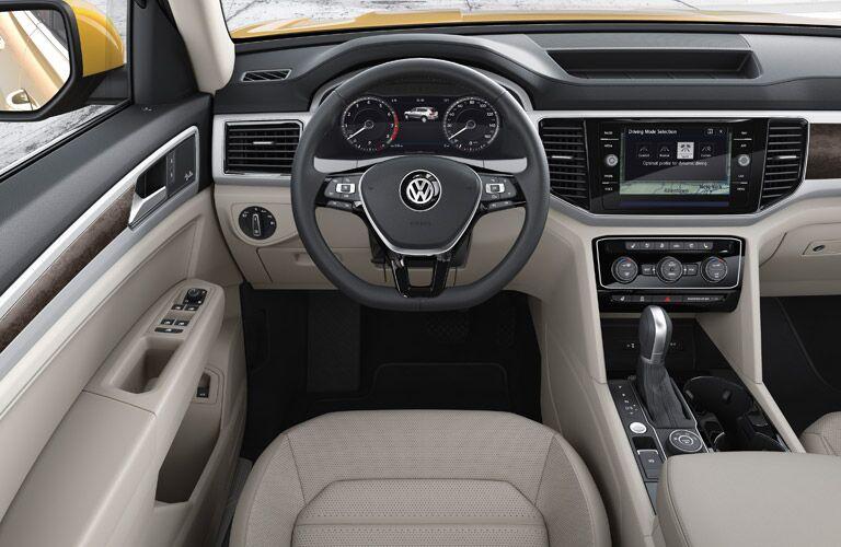 driver's side interior of 2018 volkswagen atlas including steering wheel and instrument cluster
