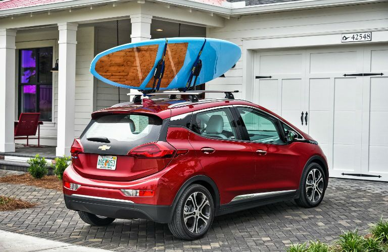2019 Chevy Bolt EV Exterior Passenger Side Rear Profile with Surfboards
