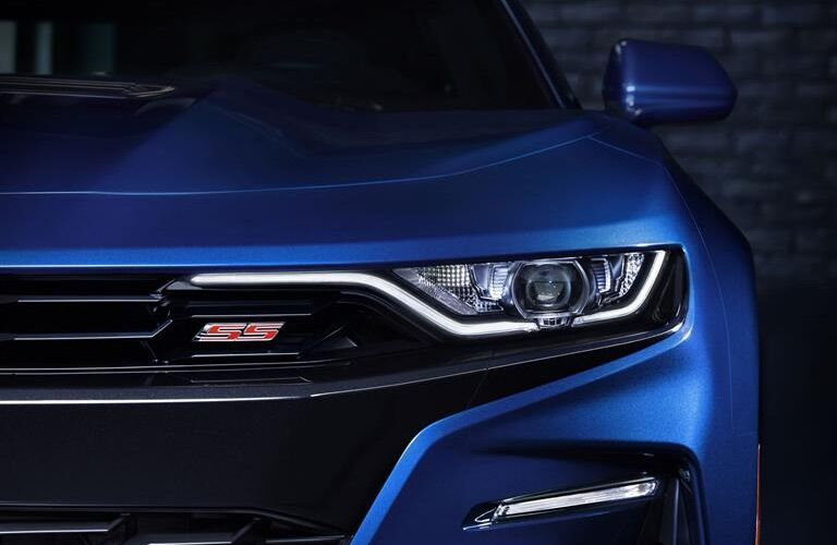 front grille and headlight of blue 2019 chevrolet camaro