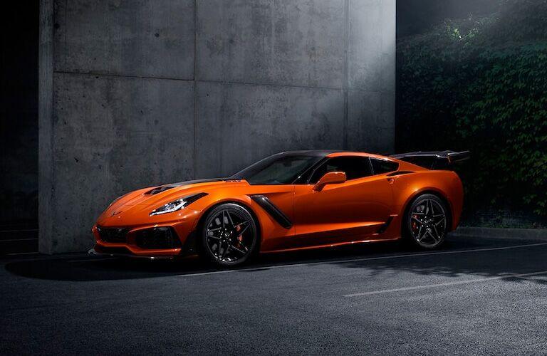 orange 2019 chevrolet corvette in parking space