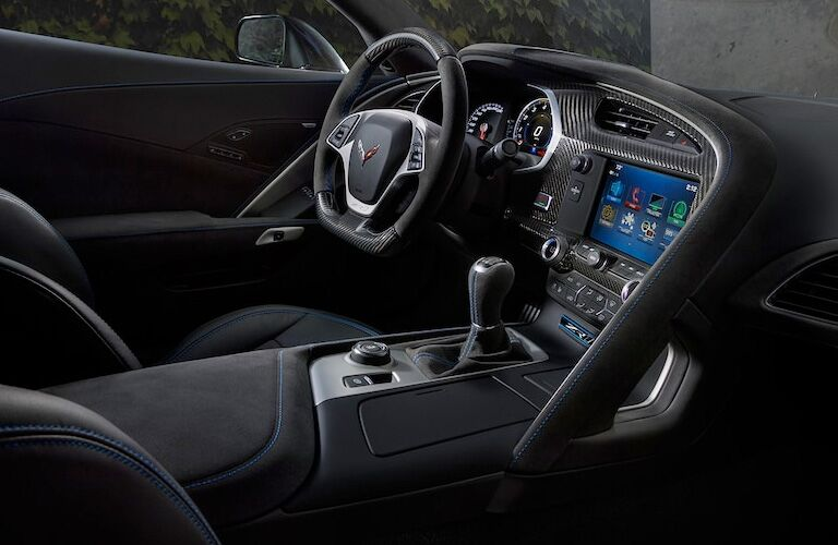 side view of front interior of 2019 chevrolet corvette including steering wheel and infotainment system