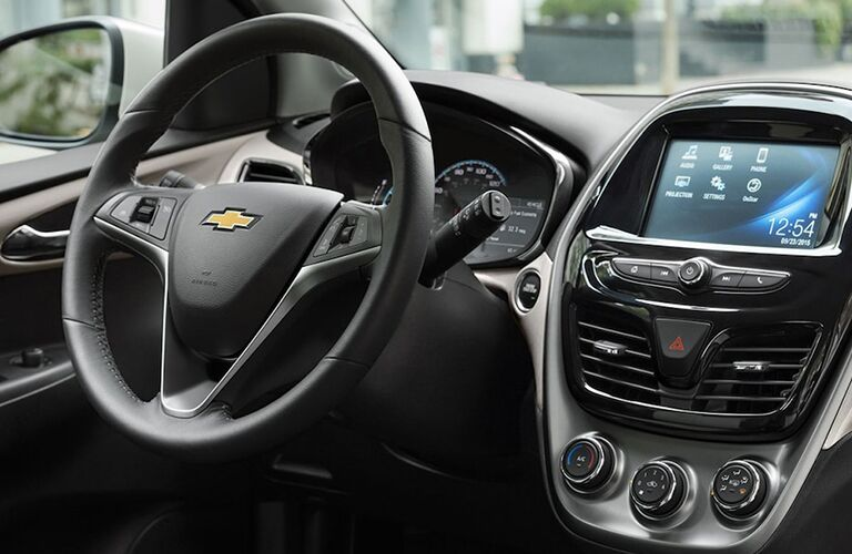 front interior of 2019 chevy spark including steering wheel and infotainment system