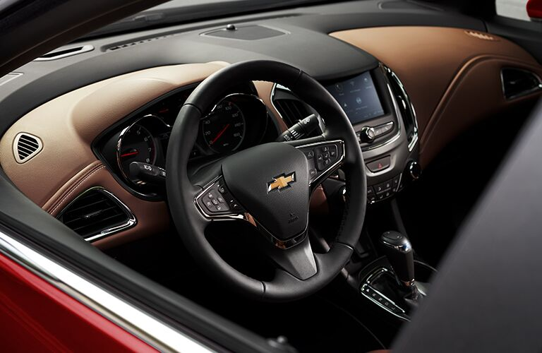 driver-side interior of 2019 chevy cruze including steering wheel and infotainment system