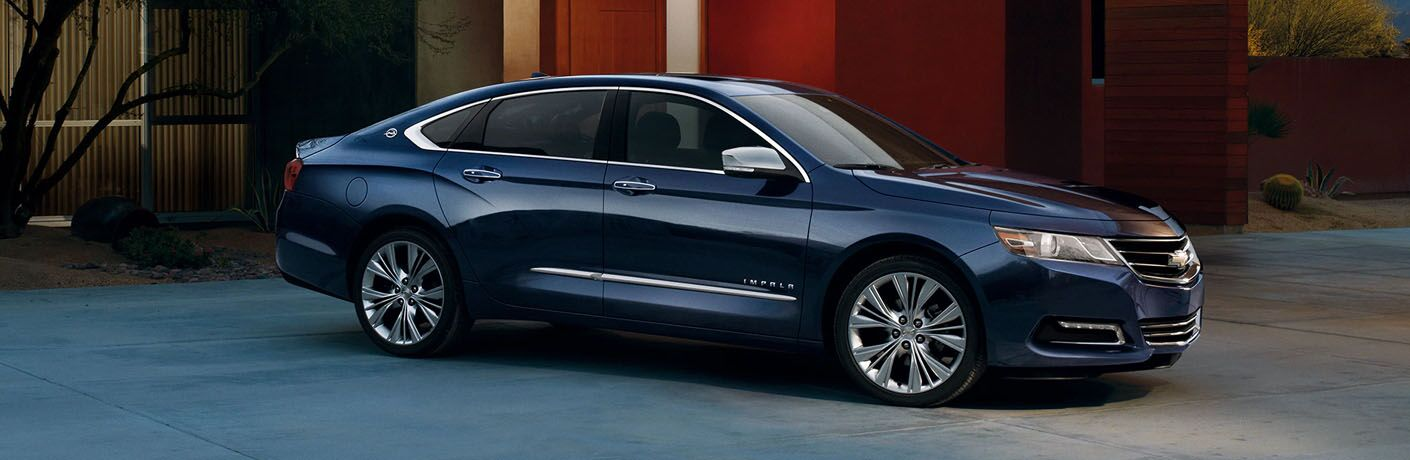 side view of blue 2019 chevy impala