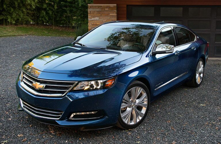 front and side view of blue 2019 chevy impala