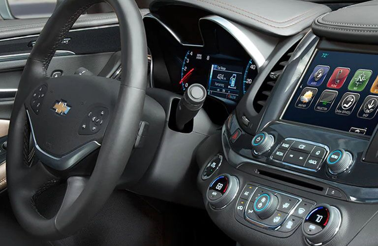 side view of steering wheel and infotainment system of 2019 chevy impala