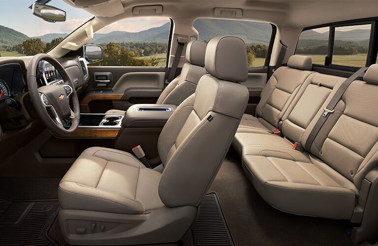 side view of interior of 2019 chevy silverado including front and rear seats