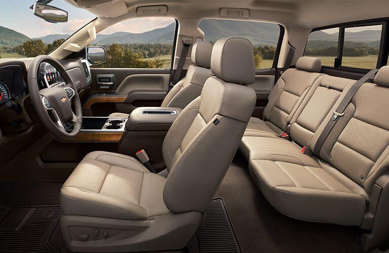 Tan Interior of the 2019 Chevy Silverado HD showing the seats