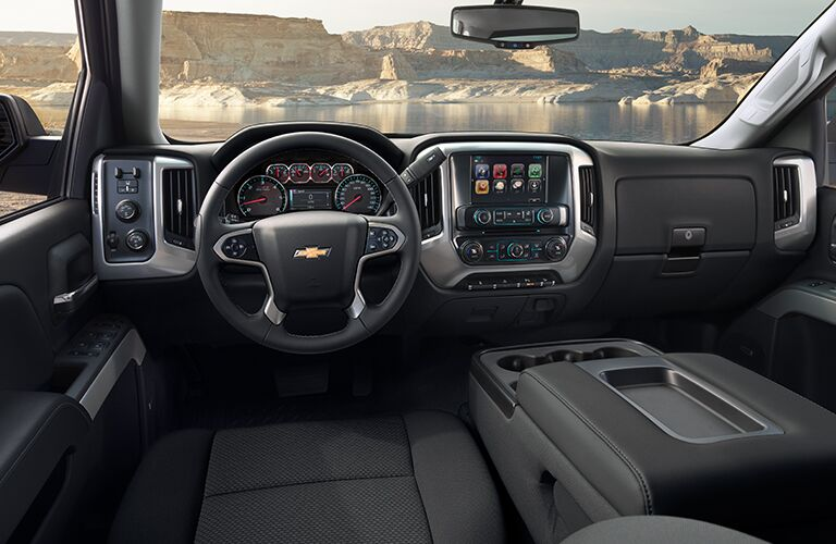 front interior of 2019 chevy silverado including steering wheel and infotainment system