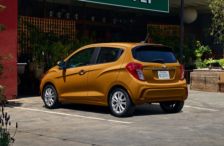 rear and side view of bronze 2019 chevy spark