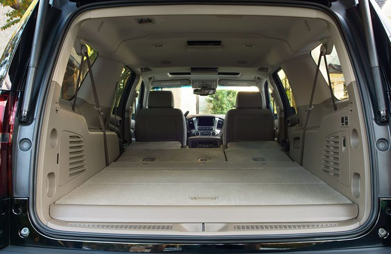 rear cargo space of 2019 chevy suburban with second and third row seats folded down
