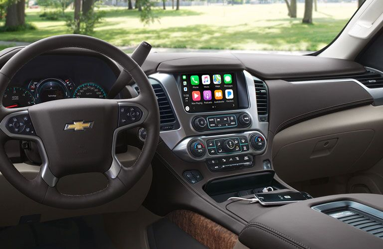front interior of 2019 chevy suburban including steering wheel and infotainment system