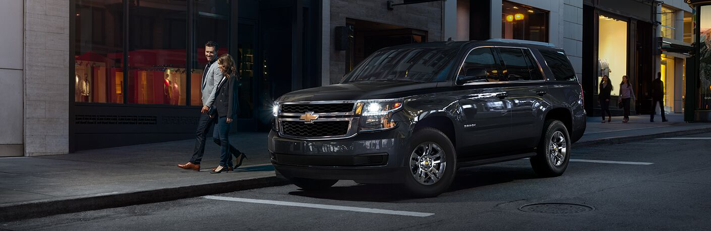 front and side view of black 2019 chevrolet tahoe
