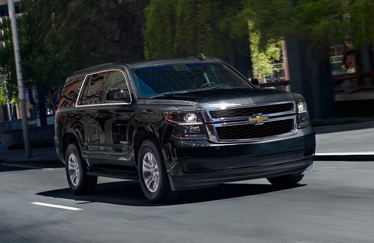 front and side view of black 2019 chevy tahoe