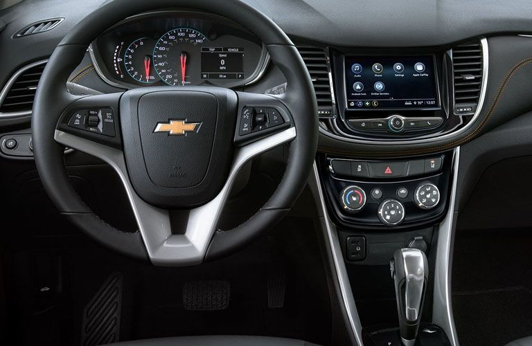 front interior of 2019 chevy trax including steering wheel and infotainment system