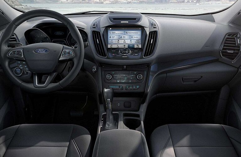 front interior of 2019 ford escape including steering wheel and infotainment system