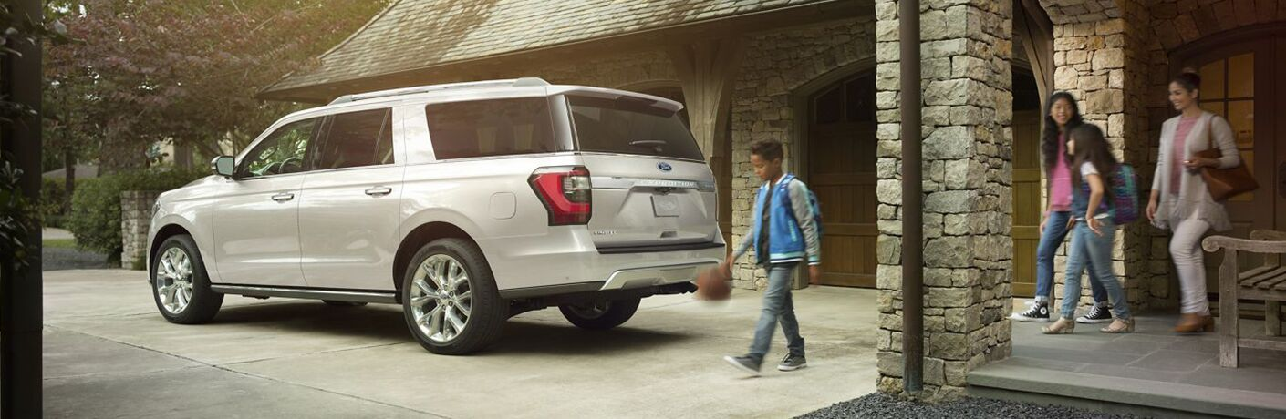 2019 Ford Expedition parked by a garage