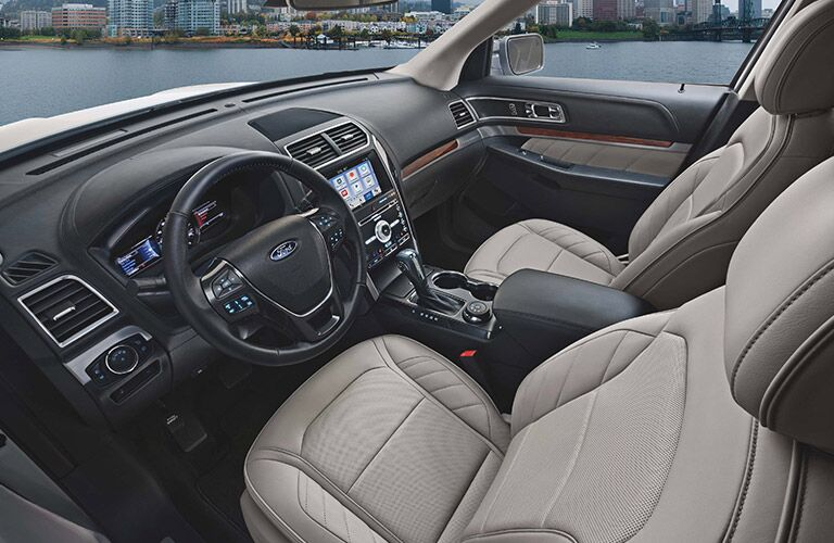 front interior of 2019 ford explorer including steering wheel and infotainment system