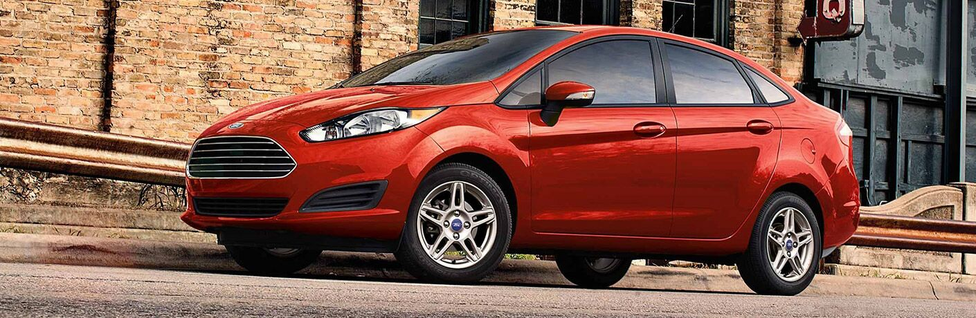 front and side view of red 2019 ford fiesta