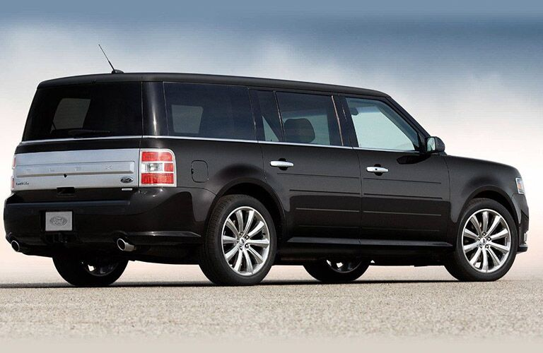 rear view of black 2019 ford flex against white and blue background