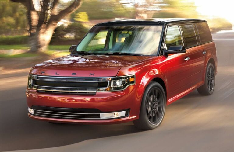 front and side view of red and black 2019 ford flex