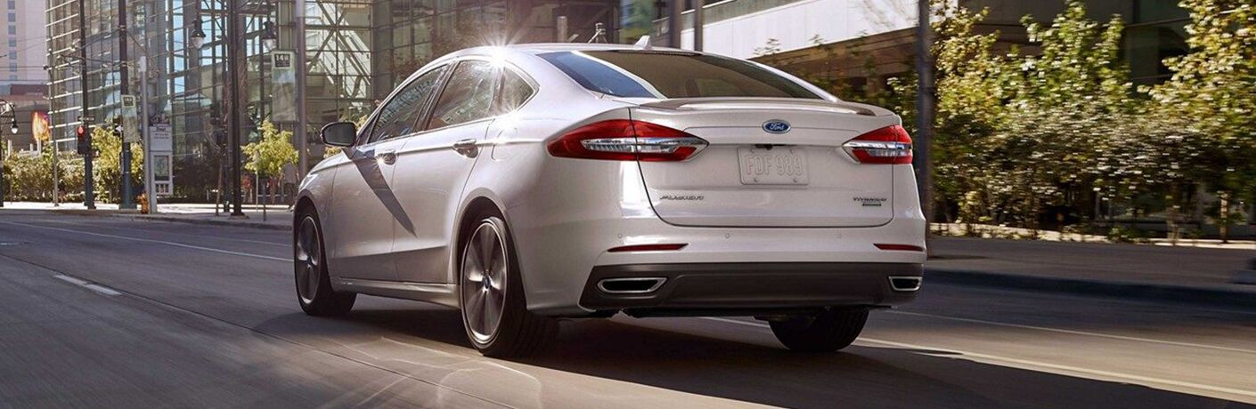 2019 Ford Fusion driving in a city