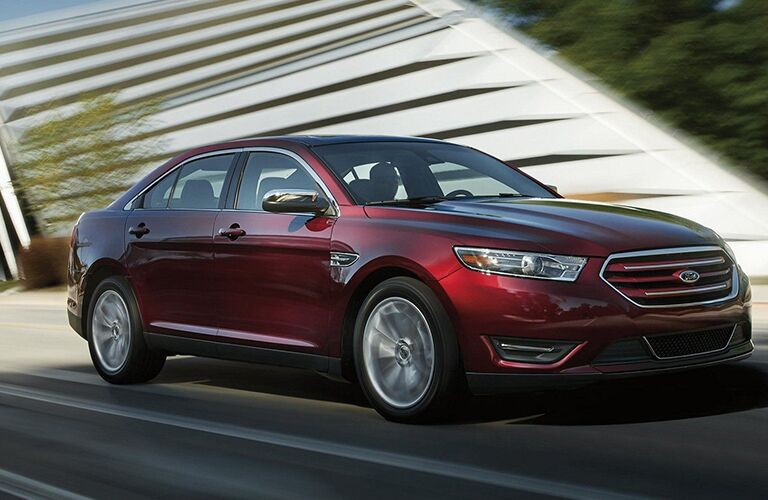 front and side view of red 2019 ford taurus