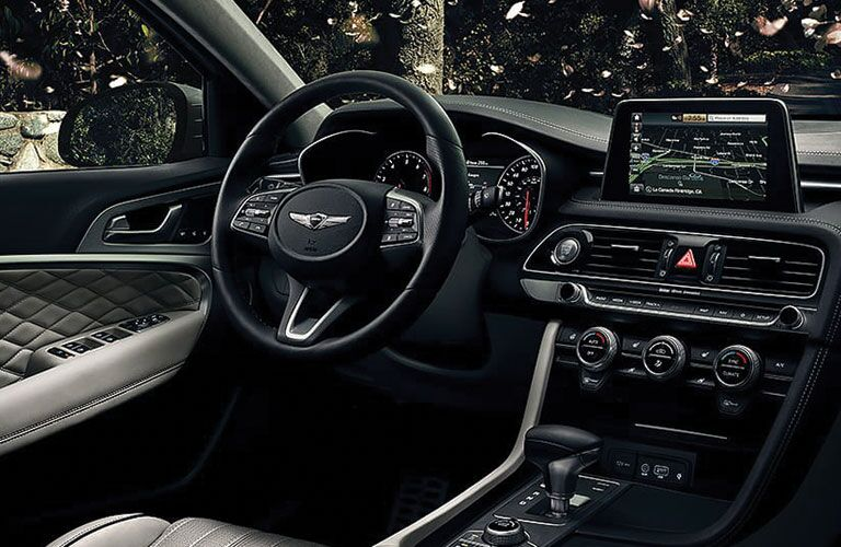 front interior of 2019 genesis g70 including steering wheel and infotainment system