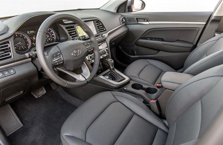 front interior of 2019 hyundai elantra including steering wheel and seats