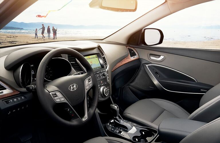 front interior of 2019 hyundai santa fe xl including steering wheel and infotainment system