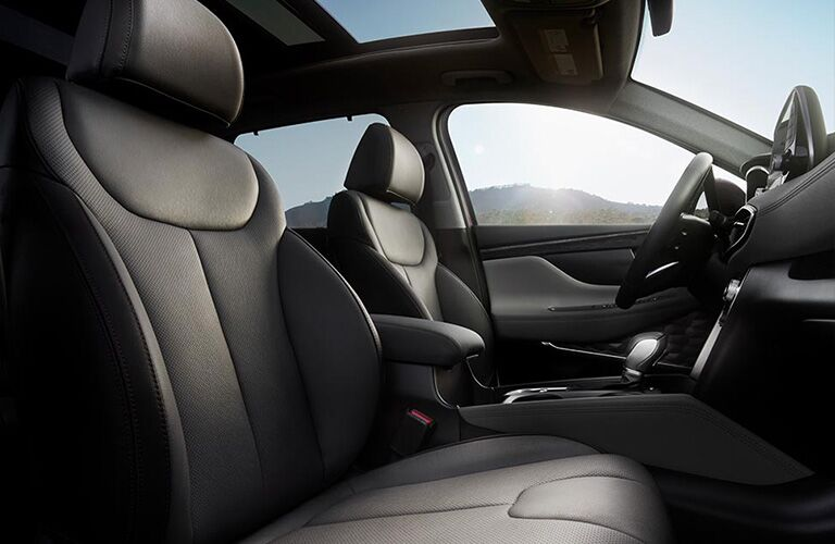 side view of front interior of 2019 hyundai santa fe including seats and center console