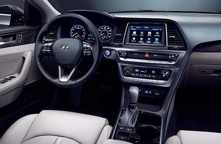 front interior of 2019 hyundai sonata including steering wheel and infotainment system