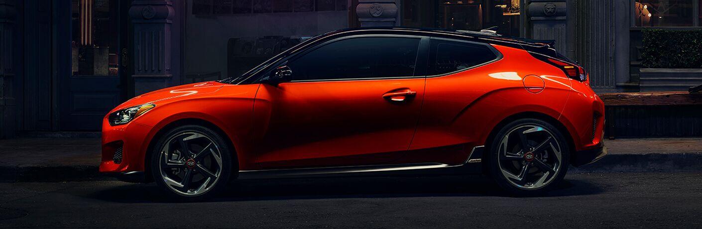 side view of orange 2019 hyundai veloster