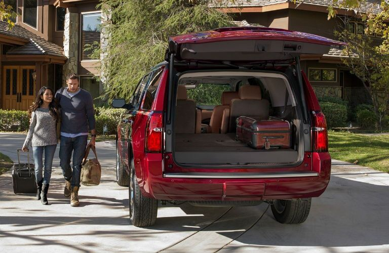 rear view of red 2019 chevrolet tahoe with liftgate open and rear seats folded down