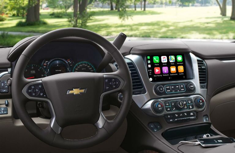 front interior of 2019 chevrolet tahoe including steering wheel and infotainment system
