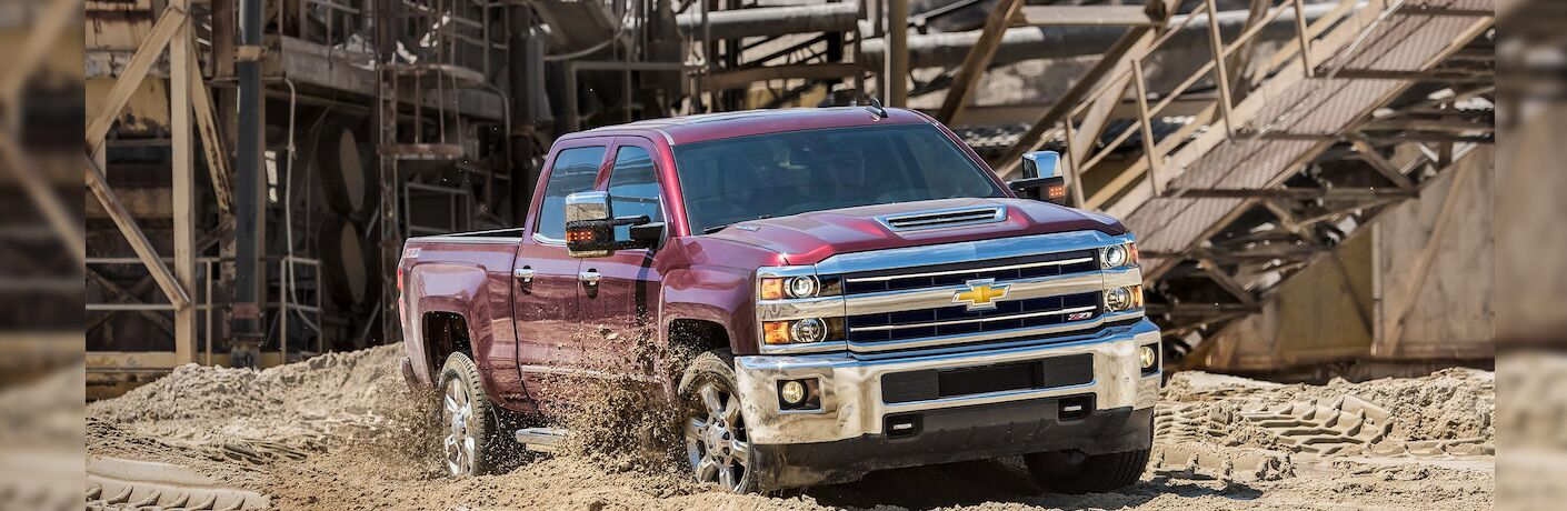 front and side view of red 2019 chevrolet silverado 2500hd