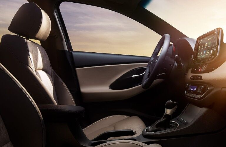 Driver Seat, Steering wheel, dashboard, and interior driver side door inside the 2019 Hyundai Elantra GT