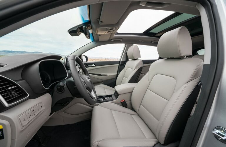 side view of front interior of 2019 hyundai tucson including steering wheel and center console