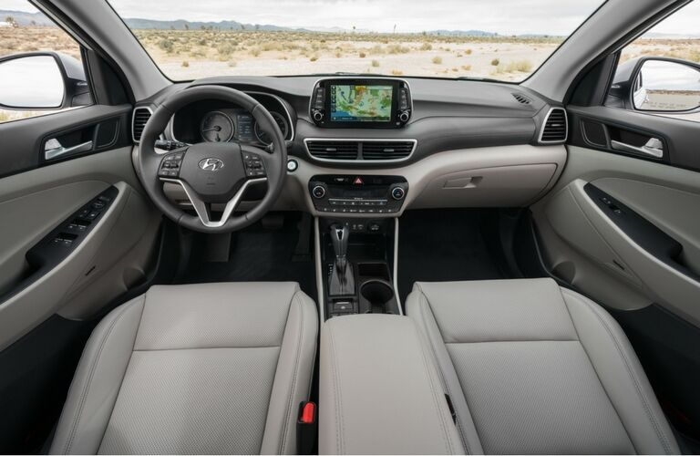 front interior of 2019 hyundai tucson including steering wheel and infotainment system