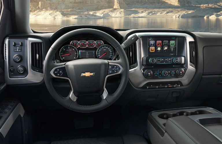 Front Interior of the 2019 Silverado HD showing the steering wheel and touchscreen