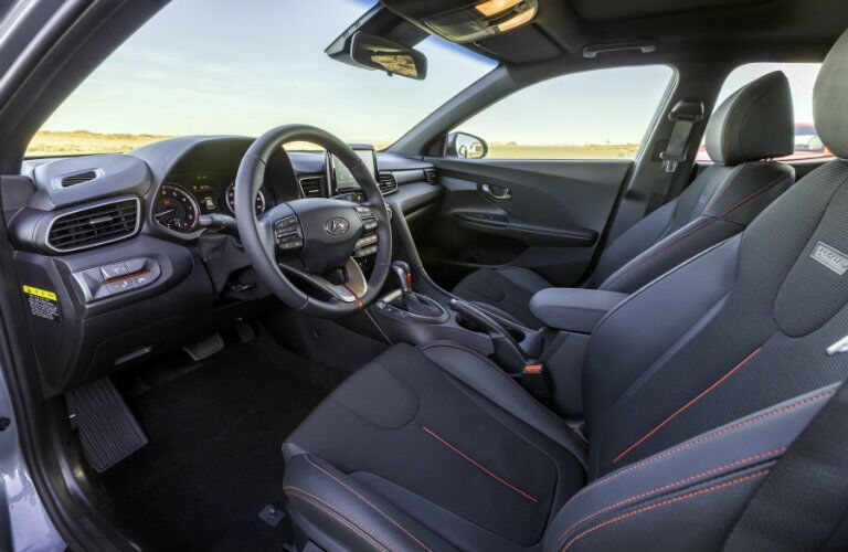 front interior of 2019 hyundai veloster including steering wheel and front seats