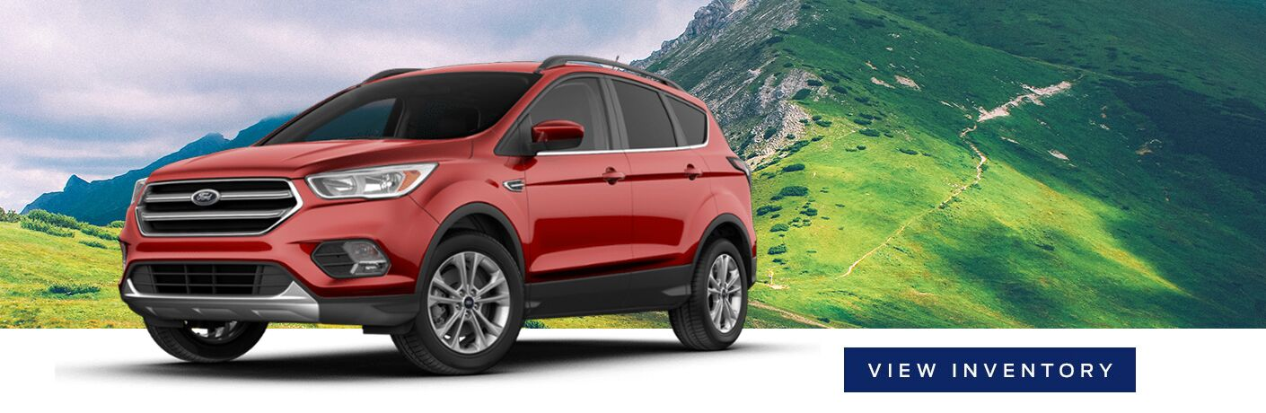 """generic ford suv vehicle in front of mountain background with """"view inventory"""" button next to it"""