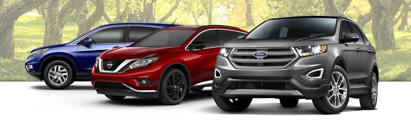 group shot of ford and nissan suvs