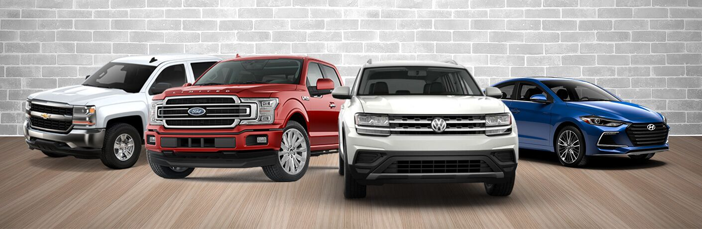 chevy truck, ford truck, volkswagen suv and hyundai car together