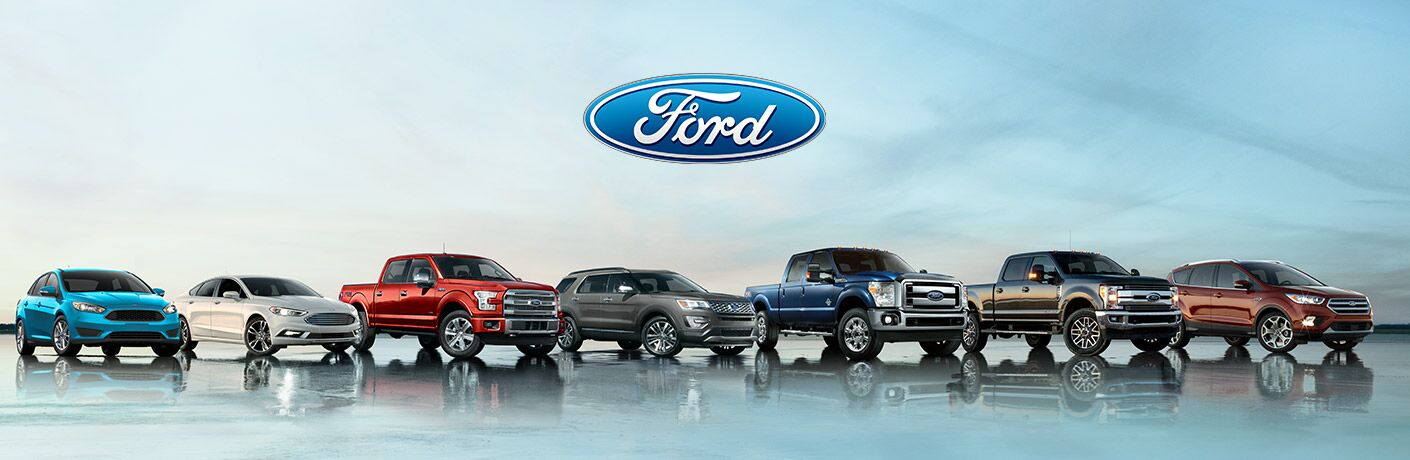 lineup of ford vehicles including cars, trucks and SUVs under Ford logo