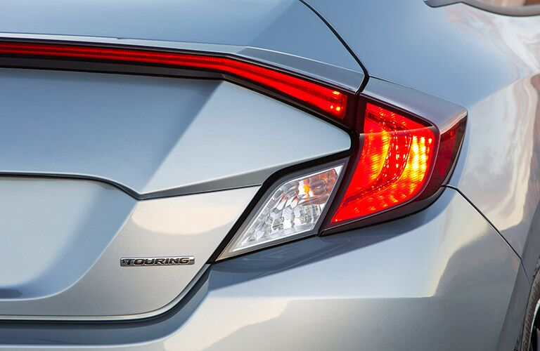 C-shaped taillights